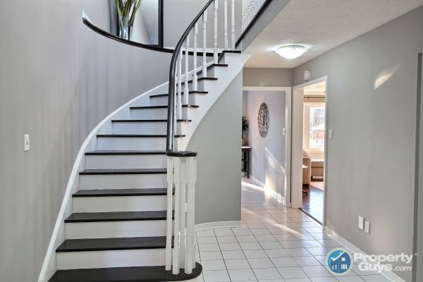 Painted staircase, white spindles, dark stain. My staircase, was almost the death of me...spindles. I painted the risers, and used a paint stain (Benjamin Moore) on the stairs. Love it. Benjamin Moore Thunder. Love that colour!! Pinterest truly inspired this DYI, hope it sells my house.