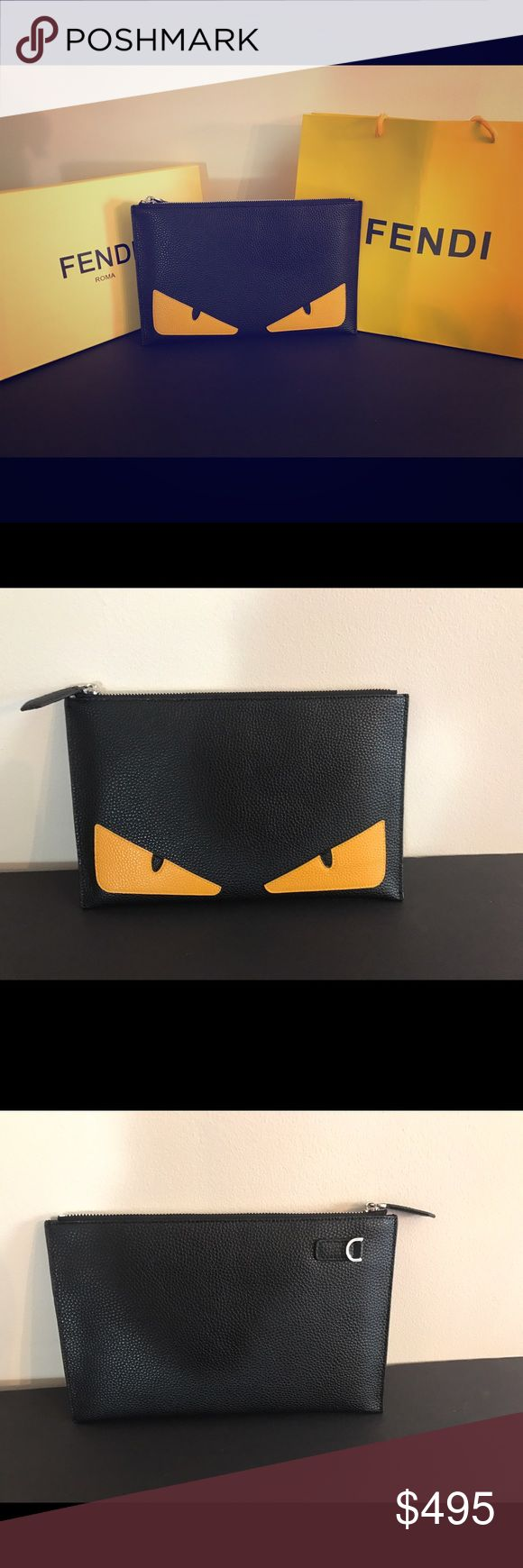 "Fendi monster black leather clutch bag Fendi monster clutch ! Unisex ! Clutch is new and comes with original box and shopping bag . Also has original sales memo . Purchased from fendi outlet . Bag is in mint condition , however inside of bag does have slight moth ball odor , I am working on fixing this and after usage it will likely dissipate . Offered here at great discount ! Measures 11"" x 7"" comes with attachable wristlet strap . Fendi Bags Clutches & Wristlets"