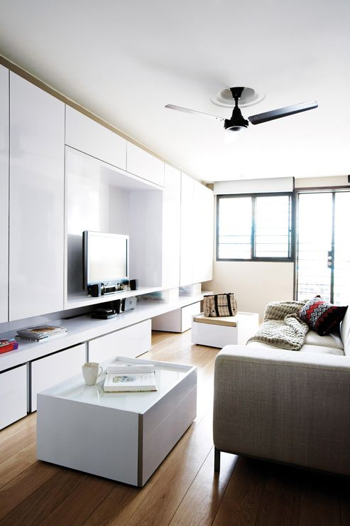 dwell interior design home decor singapore the designer created a sleek display and storage unit with plenty of room for the occupants belong - Home Decor Singapore