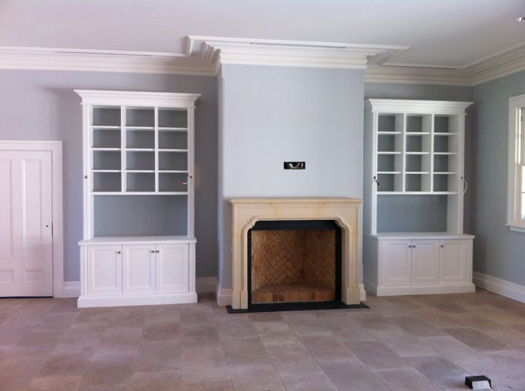 Reception bookcase joinery & Fireplace designed by Michael Bell Architects, built by Country Design & Chateau Couture respectively