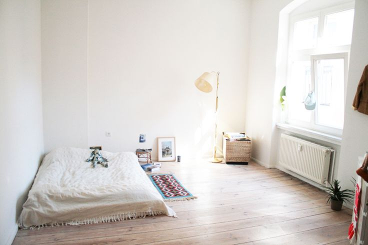 space + white + window + bed.