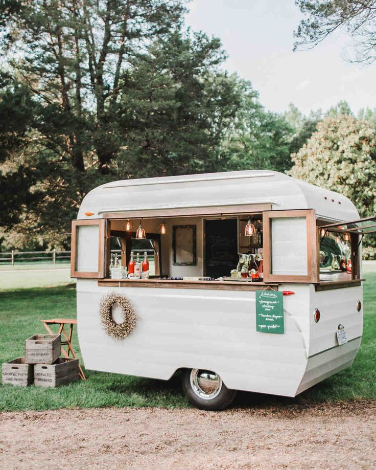 Trending Now: Drink Stations to Elevate Your Reception | Martha Stewart Weddings - It's not just about what you serve at your specialty bar, but how you serve it. Bartenders stationed in this adorable airstream trailer mixed up pomegranate whiskey sours, bourbon-thyme smashes, and pear gimlets, but our guess is that guests really came to check out the cool digs.