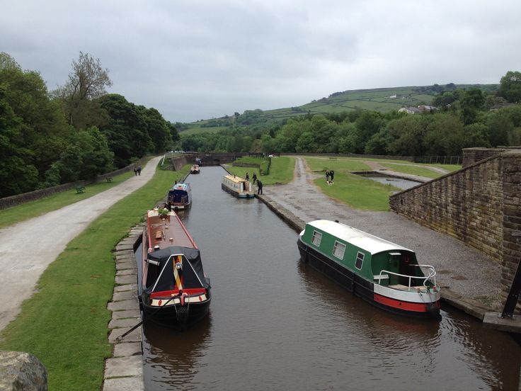 Narrowboats moored at the Bugsworth Basin, on the Peak Forest Canal, Derbyshire