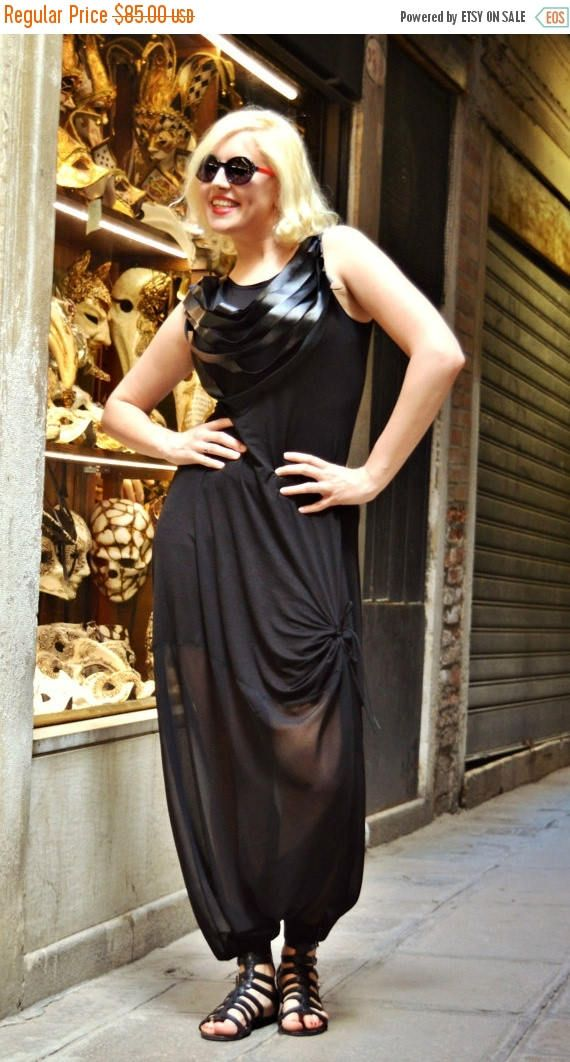 Extravagant black jumpsuit made of the finest viscose blended with chiffon. The leather fringes add a funky effect, being like a gorgeous big necklace. They can be worn both in the front and in the back. Very comfortable and playful design, being extremely soft at touch and perfect for summer. Material: 95% Viscose, 5% elastane 100% chiffon 100% eco leather  Care instructions: Wash at 30 degrees. The model in the picture is size S.  Can be made in ALL SIZES.  If you have any other specific…