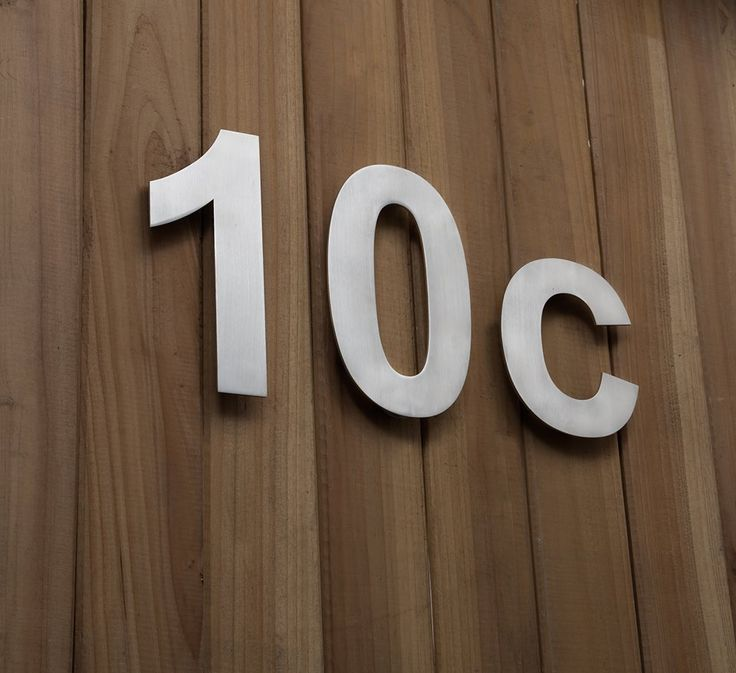 our modern house numbers and letters have hidden mounting plugs creating an ethereal floating appearance