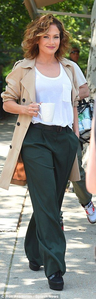Dress detective: To play her character Harlee McCord, Jlo wore a pair of wide leg green tr...