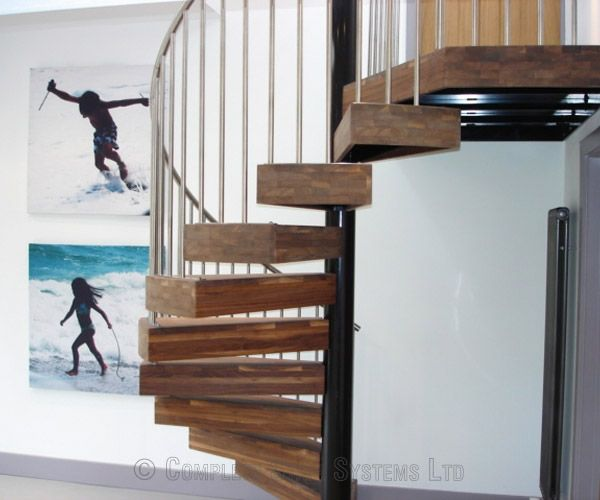 Spiral Stair with special boxed in Walnut treads and stainless balustrade