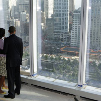 President Barack Obama and first lady Michelle Obama look down at the 9/11 Memorial while touring the One World Trade Center building under construction in New York on June 14, 2012.