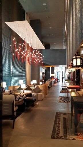 the lobby of the new south beach hotel singapore is an eclectic mix of furniture and