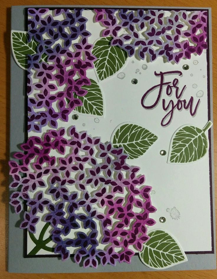 Thoughtful Branches by Stampin Up. Smokey Slate, White, Blackberry Bliss, Mossy Meadow. Sponged white paper with Wisteria Wonder, Lavender Lace, Elegant Eggplant and Blackberry Bliss before stamping the leaves/flowers in Blackberry Bliss and cutting them out. Used Wink O Stella pen to add sparkle to the flowers. Used water spot from French Foliage and stamped off in the Smokey Slate for the background.