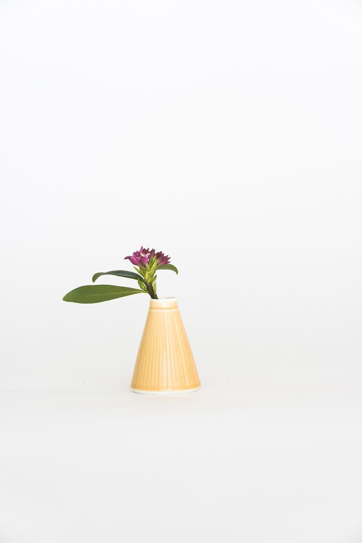 https://councilofobjects.com.au/shop/bud-vase-burnt-orange Susan Frost Burnt Orange Bud Vase. Styling: Elise Short of Council of Objects. Photography: Sven Kovac. Location: The Props Dept.