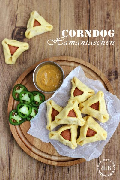 Corndog Hamantaschen for Purim! A slice of hot dog is wrapped in a crispy corn dough for a fun and festive appetizer!