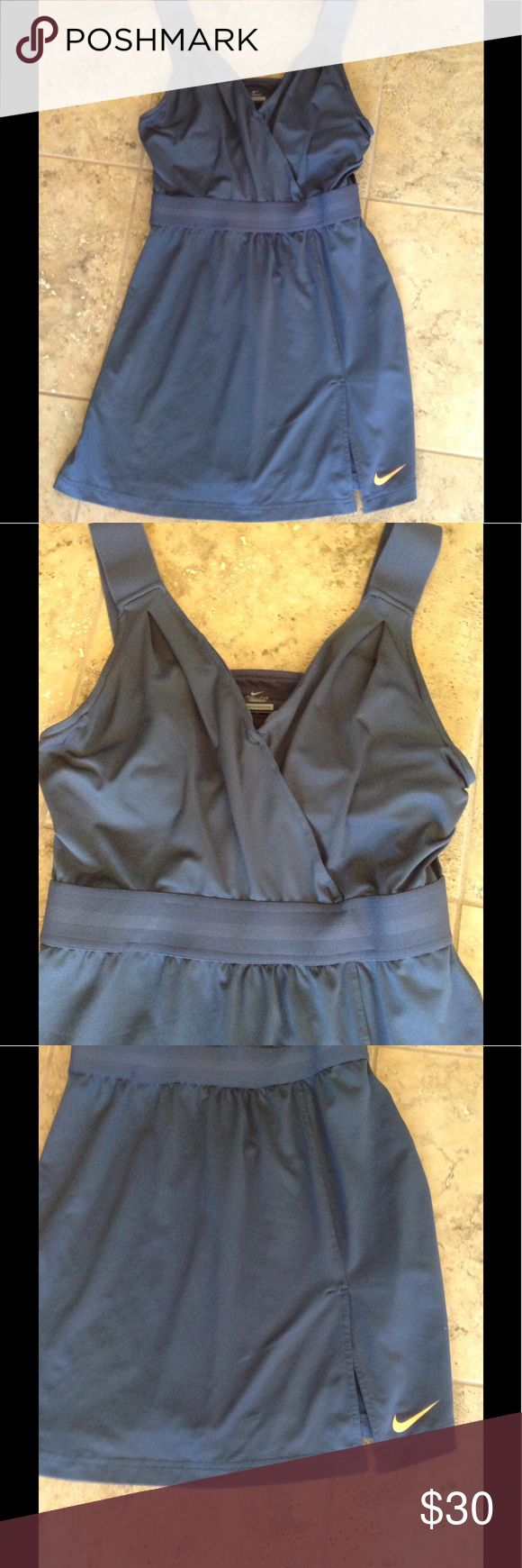 👗👗👗Cute Nike Dress👗👗👗 👗👗👗👗A really cute sporty dri- fit Nike dress. It have a built in bra and elastic band straps. It's made from 87% polyester and 13% spandex.  It's very soft and stretchy. Also in excellent condition.👗👗👗👗 Nike Dresses