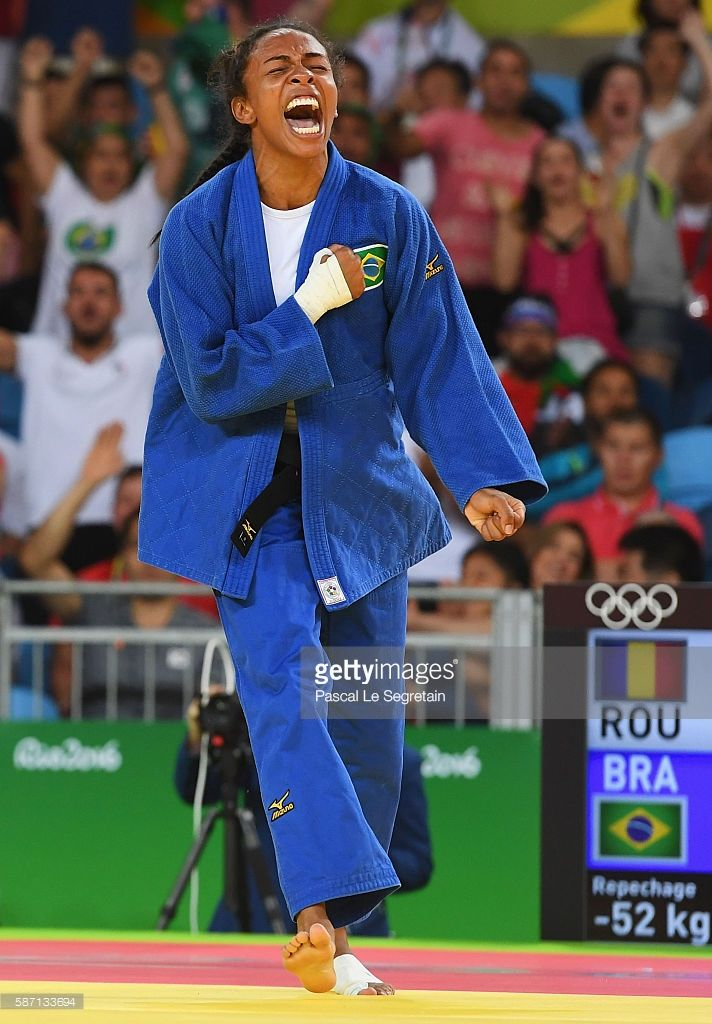 Erika Miranda of Brazil (blue) reacts after defeating Andreea Chitu of Romania during the Women's -52kg repechage contest on Day 2 of the Rio…