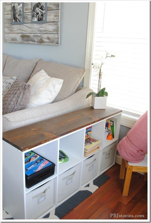 Extra Storage Side Table/ Behind the couch table. use the storage cubes for hiding toys, magazines, randoms