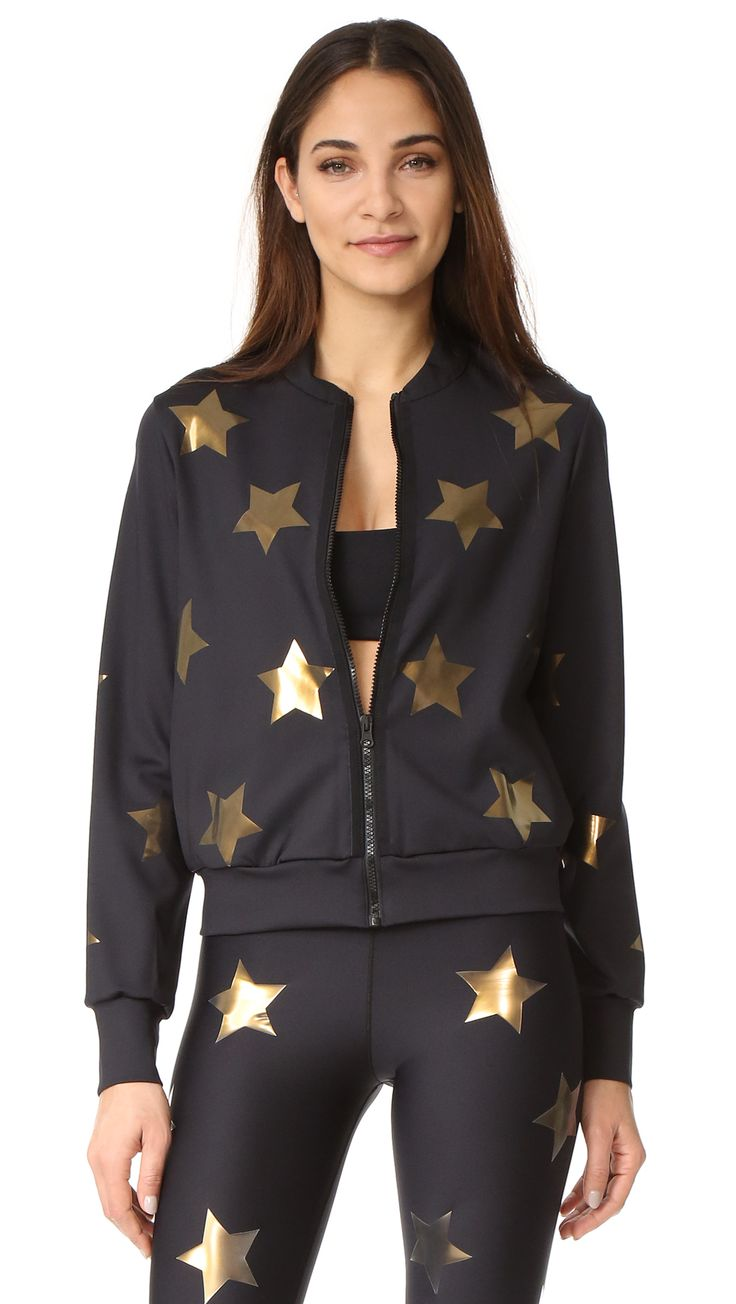 ¡Cómpralo ya!. Ultracor Knockout Bomber Jacket - Nero. Printed, gold tone stars cover this sleek Ultracor track jacket. Zip placket and on seam pockets. Gathered cuffs. Lined. Fabric: Activewear jersey. 84% nylon/16% lycra spandex. Wash cold. Made in the USA. Measurements Length: 22.75in / 58cm, from shoulder Measurements from size S. Available sizes: XL , chaquetabomber, bómber, bombers, bomberjacke, chamarrabomber, vestebomber, giubbottobombber, bomber. Chaqueta bomber  de mujer   de…