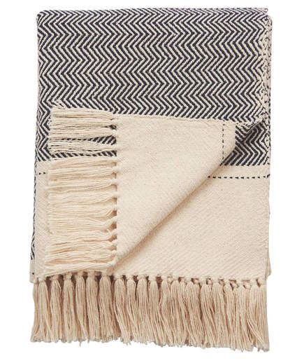 Spirit Hand Loomed Throw Blanket | Just think of wrapping yourself up in this soft throw blanket after feeling the first chill of autumn. Its black and white chevron pattern feels both of the moment and timeless, ensuring you'll be happy with it for years to come.