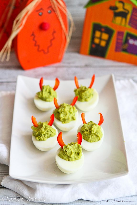 Devilish Avocado Sriracha Deviled Eggs...A fun & healthy snack for Halloween! 52 calories and 1 Weight Watchers point per serving.   cookincanuck.com #recipe #appetizer #vegetarian #glutenfree