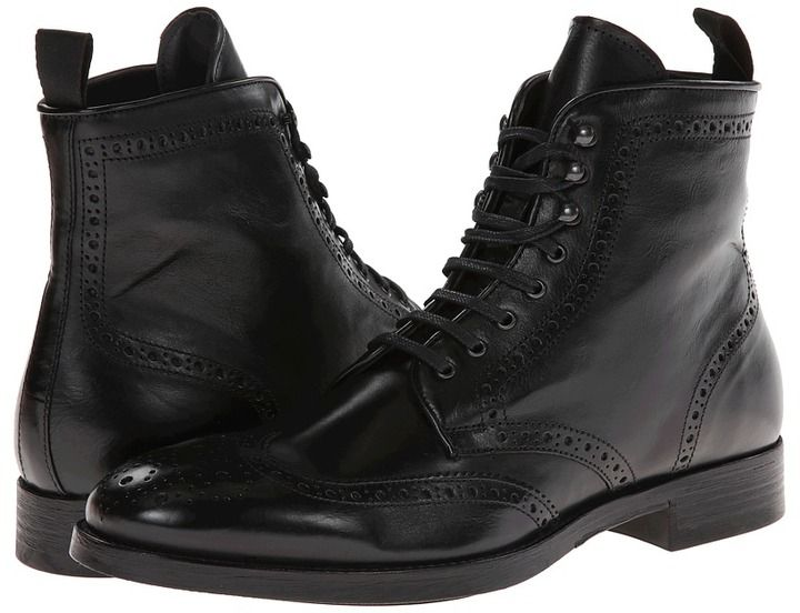 $450, Black Leather Brogue Boots: To Boot New York Brennan. Sold by Zappos. Click for more info: https://lookastic.com/men/shop_items/275791/redirect