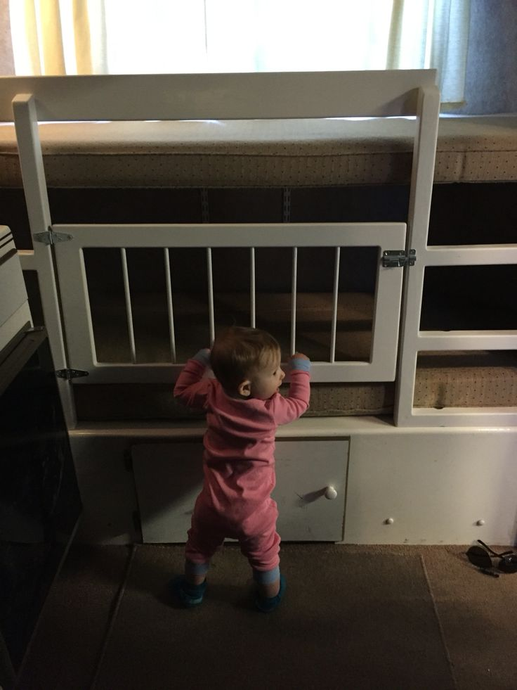 Scamp bunks made child proof. We modified our 13 foot scamp to have a top bunk with a rail and ladder, and a crib area on the bottom bunk.