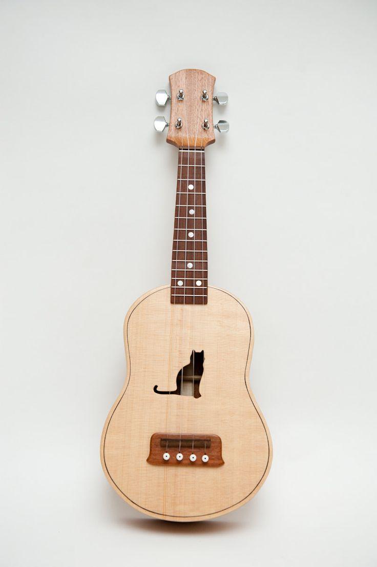 Concert ukulele (customizable sound hole of choice) Example: Cat. $400.00, via Etsy.