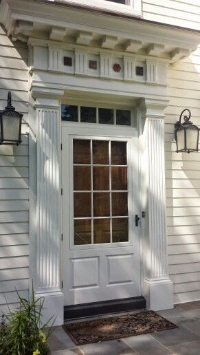 Front Entrance With Wooden Storm Door, Fluted Columns, Early Georgian With  Pediment . Mercer