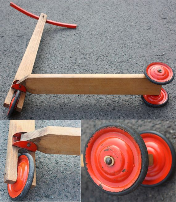 Old wooden scooter / old used toy for children with 3 wheels. Company: Hausser, made in Germany approximately 50s 60s -- Mid Century. The wooden scooter is brown. The steering is red and the wheels are red / black. A beautiful decorative object for the nursery / child´s room. Also usable as a prop. Reminiscent of days gone by. A nostalgic wooden toy. Height approx 63 cm / 24.80 Handlebar width approx 32.5 cm / 12.80 Length about 53,5cm / 21.6 Weight approx 1.02 kg Vintage condition wit...