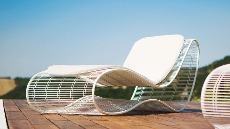 "Modern ""sunbed/chaise"" longue suitable for outdoor, garden, terrace and swimmingpool. This garden sunbed is designed by Karim Rashid, a famous industrial designer. Breez Sunbed is made of metal frame, mesh and full cylindrical wires, available in white or dove colour.  The modern sunbed's size is 170 x 64 cm, with 66 cm of height. The winding frame creates a stable seat and together with the white cushion it makes the design sunbed really comfortable."