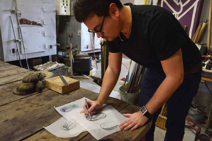 """@jirikrisica is making a hand-sketch of a new hand-blown glass pendant. This """"parachute"""" component requires extraordinary skill and the utmost precision of the glass-maker. The Babel light fixture made of it is attractive as a small or large cluster or a couple of solitary pendants."""