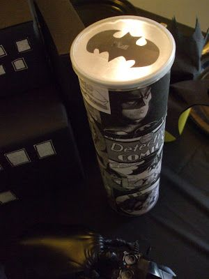 My Creative Stirrings: Batman Birthday Party. I created a bat symbol spotlight using a Pringles can. I copied comics off the internet from http://www.wickipedia.com/ and glued them onto the can using a glue stick. I taped a bat image to the inside of the lid and placed a bright flashlight inside the can. Because the flashlight was so bright and my ceilings are not very high the symbol did appear on the ceiling.