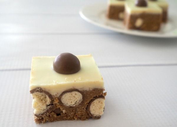 It was almost 18 months ago that I first published a recipe for this no bake Malteser Slice on the blog and looking back at the photos I took along with the post itself I cringe just a little bit. I have been meaning to update this recipe and it's photos for such a long time but just couldn't justify making this delicious and easy slice for no reason, so when I was planning our little man's 2nd birthday celebrations, I knew I had the perfect excuse.