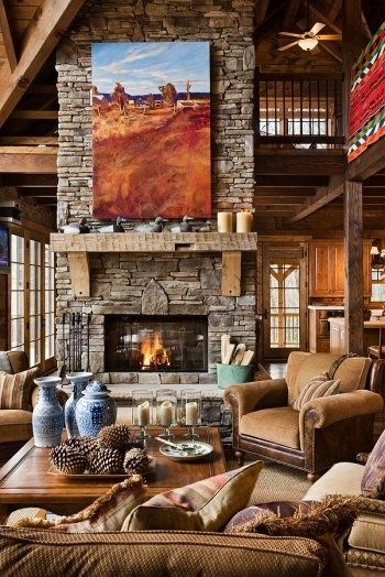 Stone fireplace - open expansive great room  mountain-modern-living-area.   It needs a large painting.  For western - Native American or landscape paintings check out the art of Joseph Trakimas.