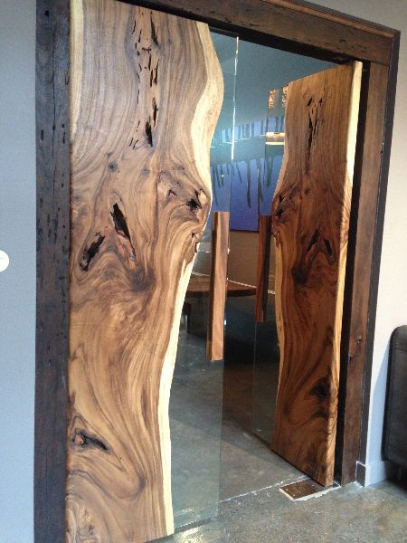 Doors of live-edge wood slabs and glass. Modern rustic design: