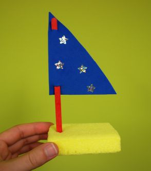 What You Need: 1. Sponges ( I cut mine in half to make smaller boats) 2. Craft Foam 3. Small Popsicle Stick 4. Stickers  First cut a triangle out of foam to make a sail for the boat. Make small cuts at top and bottom (just big enough for popsicle stick to fit through) -thread the popsicle stick through the sail. Then make a small hole in the sponge so popsicle stick will fit tightly. Let kids decorate with stickers!