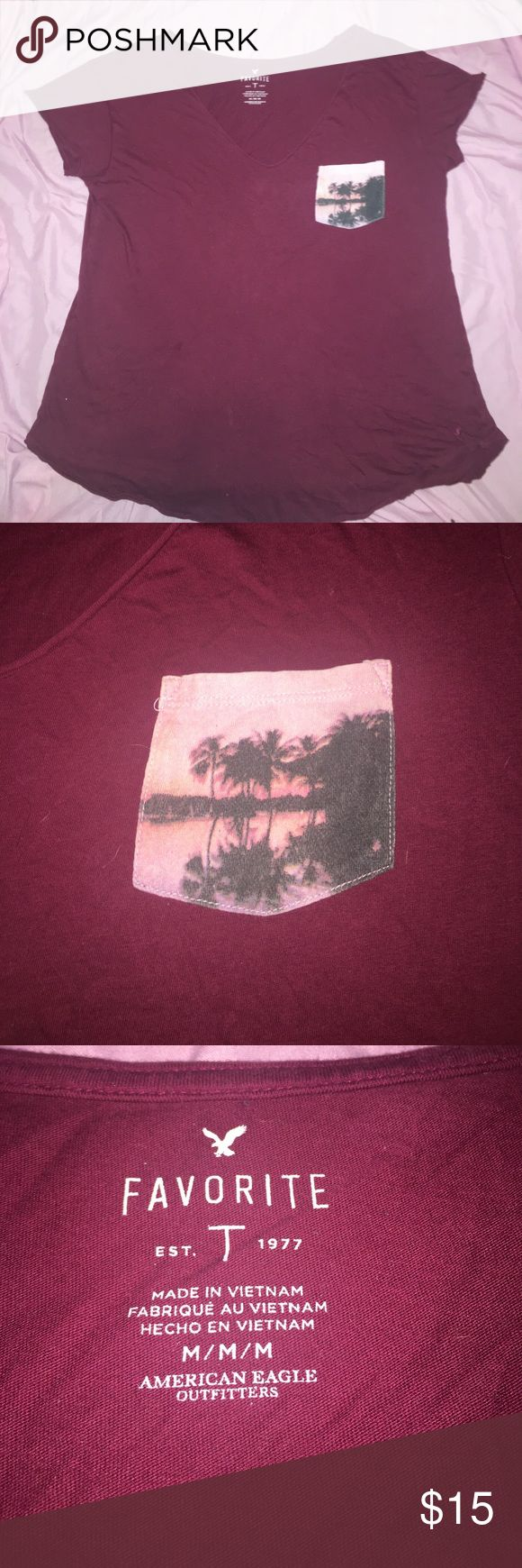 American Eagle Pocket t-shirt Maroon Pocket tee from American Eagle Outfitters. Only worn a couple of times because its too big on me. American Eagle Outfitters Tops Tees - Short Sleeve
