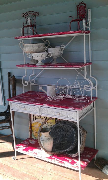 Bakers rack after final painting and decorated (still missing the banner across the top). See it in person at Victorian Lane Bed & Breakfast.