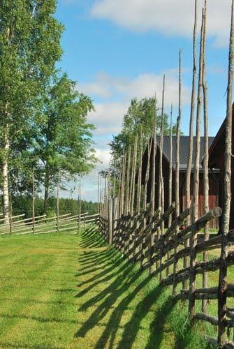 Roundpole fence, Lindesnäs, Sweden.