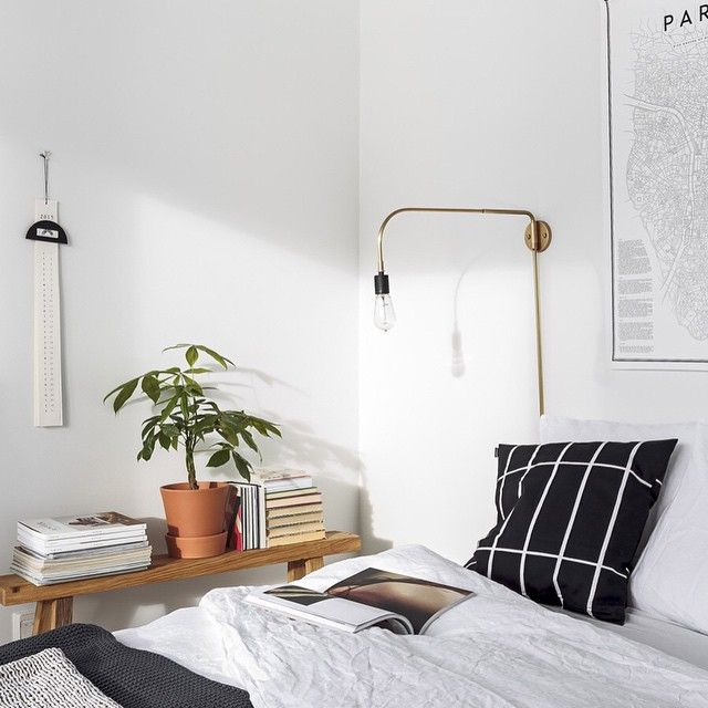 Looking for ideas to create unique bedside lighting? With so many options available to you, Interior Stylist @susanna_vento picked a great one. In a bedroom she styled for the Sato apartments in Finland, Susanna opted for a brass wall mounted light. A perfect solution if you're working with a smaller space, or if your wall seems a bit bare above your bed - it's a great way to add an element of height to help create balance.  Photography by @TuomasUusheimo
