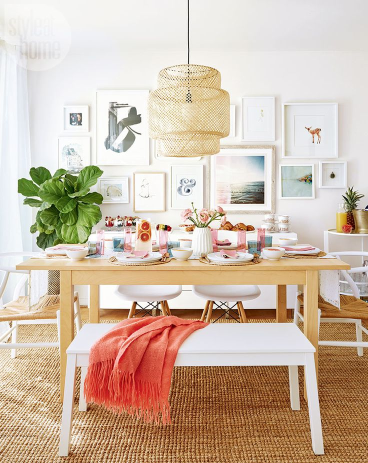The table is set for a casual brunch, with Morgan's pretty gallery wall forming a chic backdrop. A natural sisal rug and woven light fixture are serendipitous matches for the beachy look. | Image: Stacey Brandford | Designer: Morgan Lindsay | #StyleAtHome #Entertaining #HolidayHome #Christmas