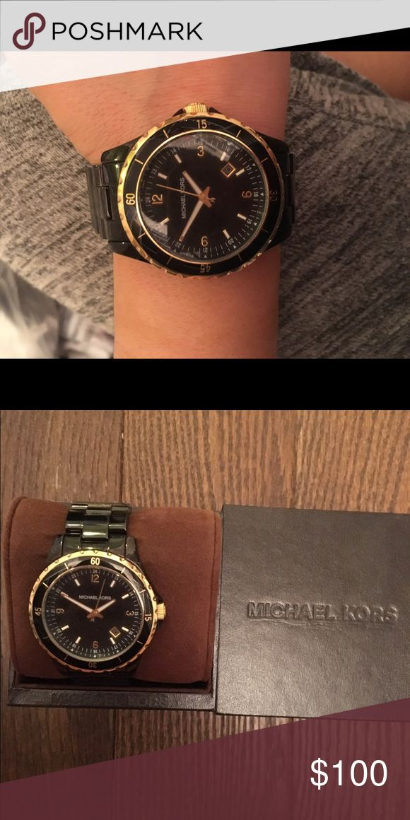 Black Michael kors watch Beautiful black watch with gold detailing looks like it was just bought worn a few times KORS Michael Kors Accessories Watches