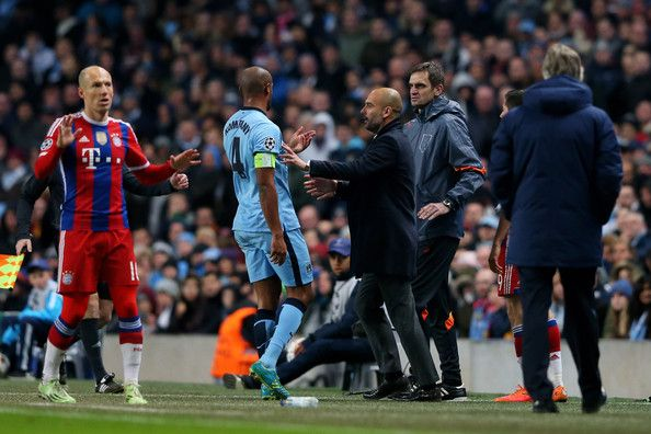 Josep Guardiola the head coach of Bayern Muenchen holds back Vincent Kompany of Manchester City as he argues with the fourth official during the UEFA Champions League Group E match between Manchester City and FC Bayern Muenchen at the Etihad Stadium on November 25, 2014 in Manchester, United Kingdom.
