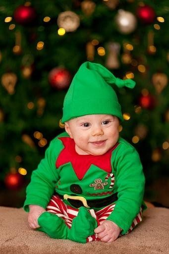 Baby dressed up an elf costume, a great Christmas baby photo!