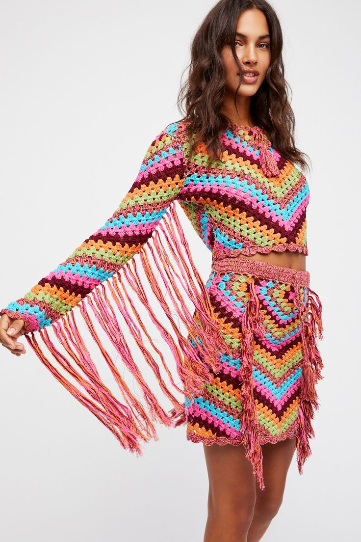 Joni Crochet Set | Colorful sheer knit crochet set, inspired by decades past, featuring allover fringe detailing.   **Top:**   Cropped to the natural waist   Drawstring neckline   Scalloped hem   **Skirt:**   A-line silhouette   Drawstring elastic waistband   Scalloped hem