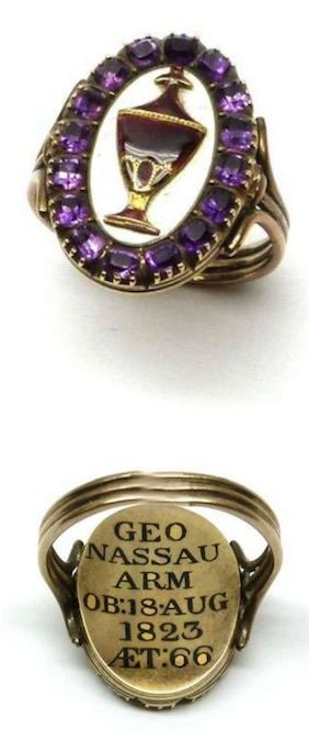 George IV gold, enamel and amethyst oval mourning ring, English 1823 , with a central applied enamel urn on white enamel ground and with an outer border of square amethysts, enamelled to the reverse: ''Geo Nassau Arm Ob: 18 Aug 1823 aet 66'', reeded gold shank.