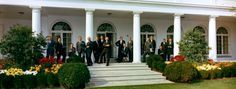 President John F. Kennedy's aides pose on the West Wing Colonnade, White House, Washington, D.C. Left to right: Kenneth P. O'Donnell, Pierre Salinger, Jerome B. Wiesner, Larry O'Brien, Kermit Gordon,Lee C. White, Timothy J. Reardon, Jr., Charles A. Horsky, Edward A. McDermott, Walter W. Heller, Ralph A. Dungan, General Chester V. Clifton, Theodore C. Sorensen, Richard W. Reuter, Bromley Smith, McGeorge Bundy. #spindoctors