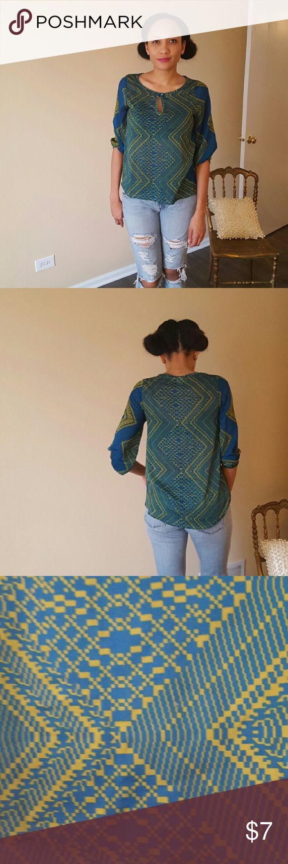 Groovy Blouse (Blue & Green) Groovy Baby! Blouse is blue and green with a keyhole in the front. Fits loose with an elastic band at the arms to give added flare & form. Tops Blouses