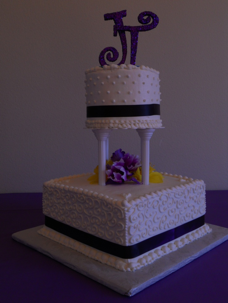 Square Wedding Cakes - 10 square with a round 6 top tier.  Real ribbon and artificial flowers.