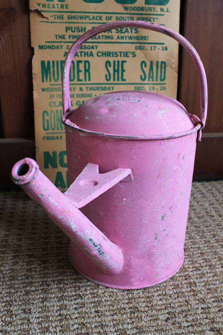 pink galvanized watering can