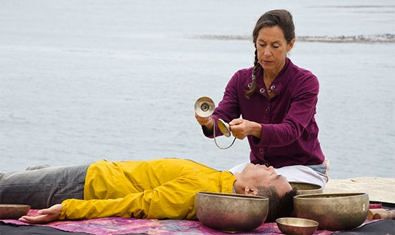 Edmund Jin receives a Tibetan bowl sound healing session with Diáne Mandle by the ocean.
