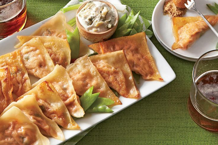 Buffalo Chicken Pot Stickers - Best Party Appetizer Recipes - Southernliving. Recipe: Buffalo Chicken Pot Stickers Serve up a familiar party appetizer with a twist with savory buffalo chicken pot stickers. The light and crunchy textured of a fried wonton paired with a classic party favorite make for an amazing appetizer that will keep this on the party menu for celebrations to come. Reviewers also suggest serving with a side of blue cheese. The recipe makes four dozen, but this delicious…